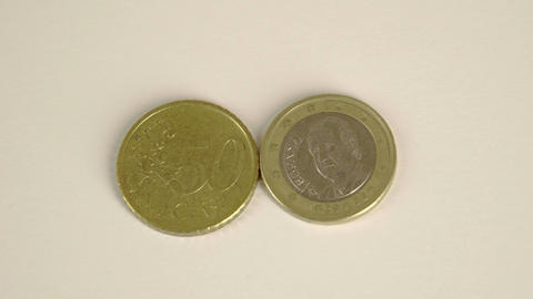 Two Euro coins the back of a 50 Spain cent and fro Footage