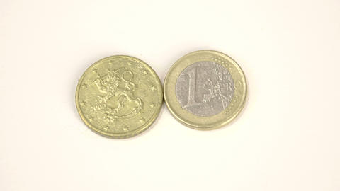 A 2000 version of a Finnish Euro coin and a 1 Euro Live Action