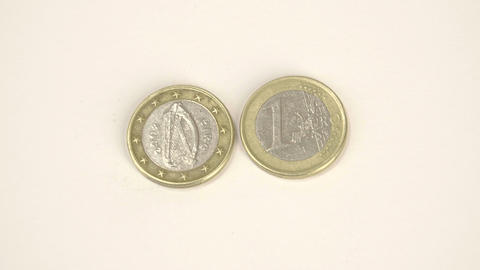 A harp image on a Ireland Euro coin and a 1 Euro c Live Action