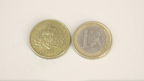 Euro Italy coins on the table one gold coin and a  Footage