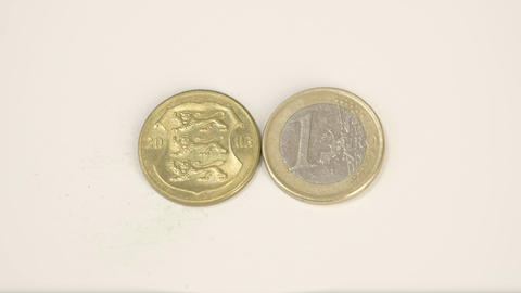 2003 version of an Estonia gold coin and a 1 Euro  Footage