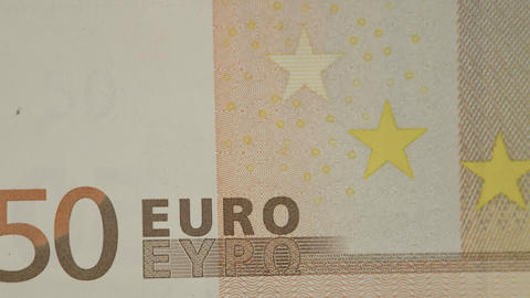 Close up view of the text of the 50 Euro bill Live Action