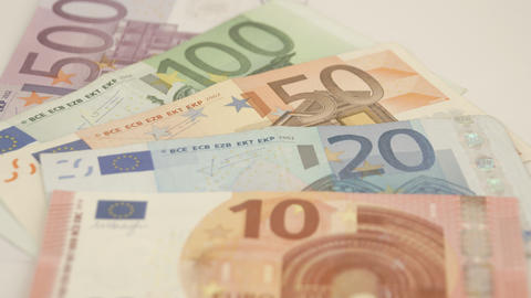 Five Euro bills on the table Live Action
