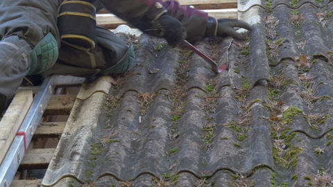A Roofer Is Getting Off The Nails From The Roof Pl stock footage