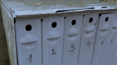A big mailbox with eight small holes Live Action