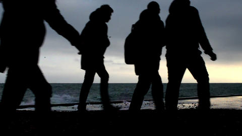Young people silhouettes on the beach Footage