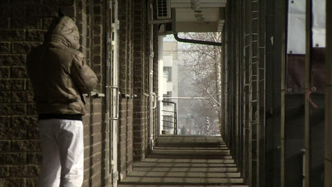 A Guy Back On The Street In The Winter Building Co stock footage