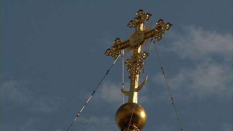 Christian gold cross on a background of clouds and Footage
