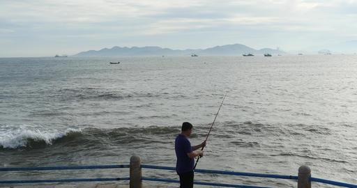 4k Man Fishing On The Coast stock footage