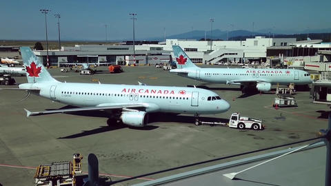 Air Canada airplanes prepare to flight at YVR airp Footage