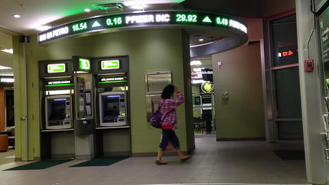 Woman Leaving The TD Bank Passing By Atm Machine stock footage
