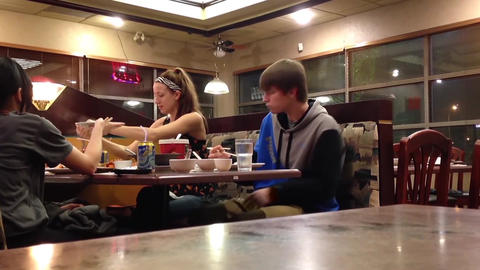 People eating chinese food at chinese restaurant Footage