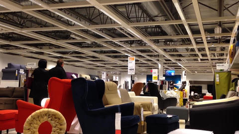 Motion of people shopping their furniture inside I Footage