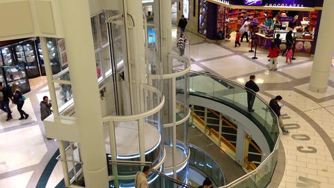 One side of shopping mall with elevator going down Footage
