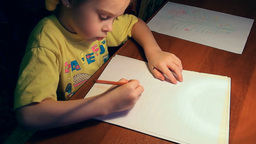 Pretty Little Girl Drawing With Concentration stock footage