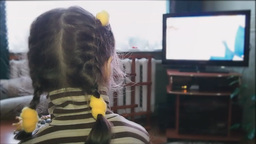 Little Girl Watching TV stock footage