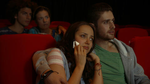 Friends Watching Sad Movie In Cinema stock footage