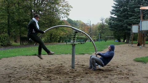 Two Adults Have Fun On The Seesaw Springer - Timel stock footage