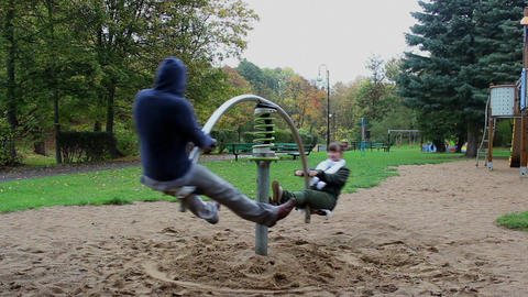 Two adults have fun on the seesaw springer 2 Footage