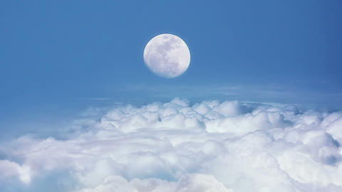 Flying Over The Clouds With The Moon stock footage