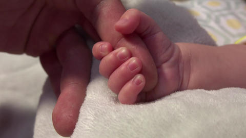 Newborn Baby Squeezing Dad's Hand Footage
