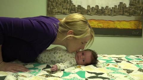 Mother Kissing Newborn Baby Footage