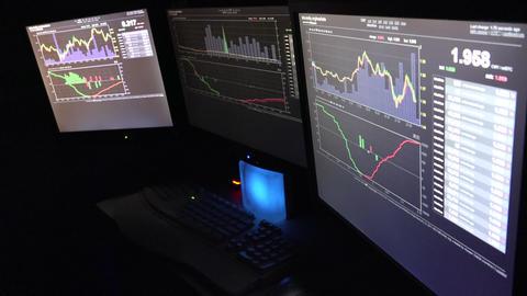 Three Computer Screens of Bitcoin Traders Footage