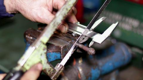 Measuring a Screw Piece with a Caliper Footage