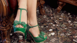 Psychotherapist green shoes feet detail Footage