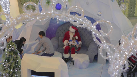 chinese family taking taking photos with Santa Footage