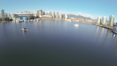 great day aerial over boats and birds towards BC p Live Action