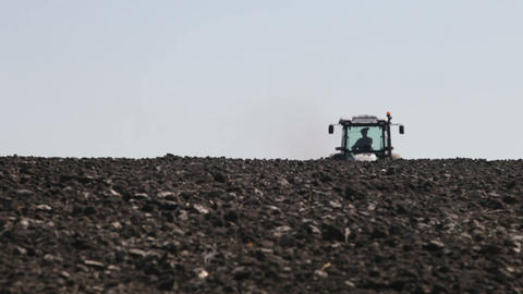 tractor plowing the black earth Footage