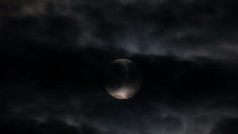 full moon moving between clouds Footage