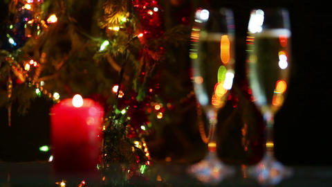 Champagne And Candle Against Christmas Lights stock footage