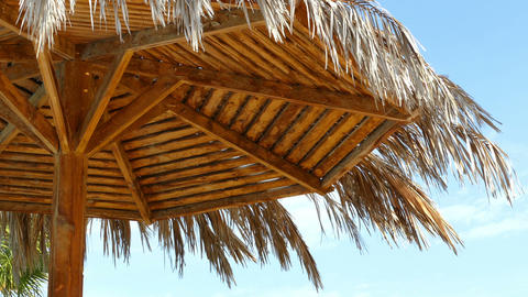 Beach Umbrella Against Blue Sky stock footage