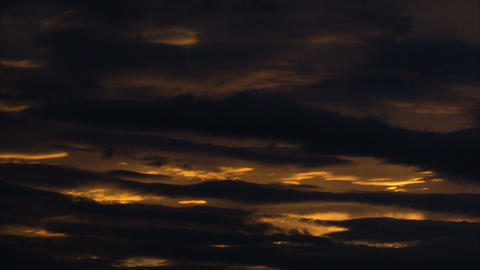 Time lapse of clouds passing gently during sundown Footage