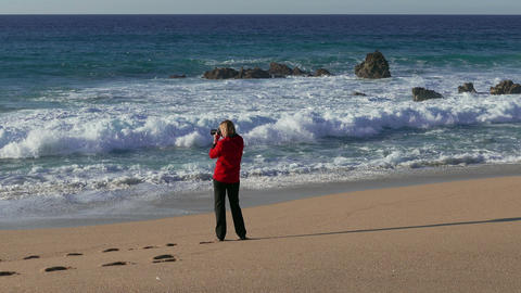 Woman Make Photo Waves In Ocean stock footage