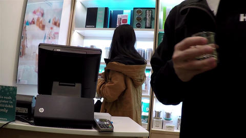 Woman buying tea inside Burnaby shopping mall with Footage