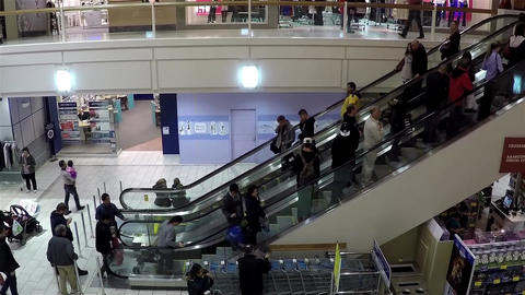 Busy escalators in Coquitlam center shopping mall  Footage