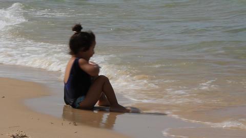 Little girl on seashore Live Action