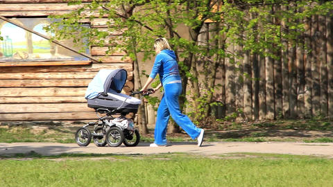 Mother with perambulator Footage