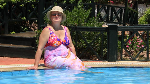 Woman by pool Footage