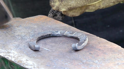 Blacksmith making horseshoe Footage