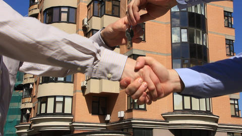 Business handshake and giving the keys Footage