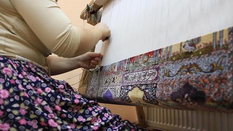 Carpet Weaving. Turk Woman Making A Silk Carpet stock footage