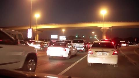 Dubai city traffic at night, traffic jam. United Arab Emirates Live Action