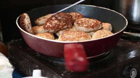 Pan with cutlets on electric kitchen range Footage