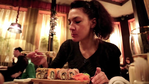 Woman eating sushi in a Japanese restaurant Footage