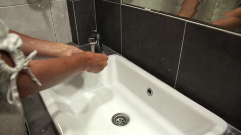 Woman washes hands Footage