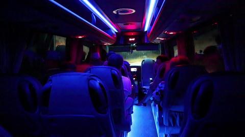 People inside salon of minibus Footage